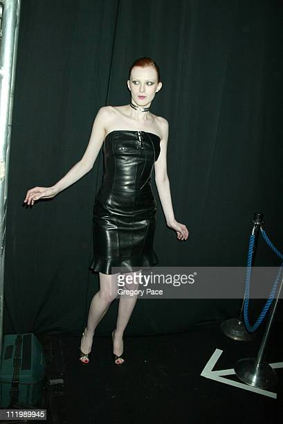 Karen Elson backstage wearing Luca Luca before the show
