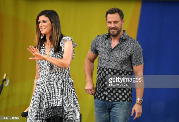 Karen Fairchild and Jimi Westbrook of Little Big Town walk onstage on ABC's 'Good Morning America' at Rumsey Playfield Central Park on June 23 2017...