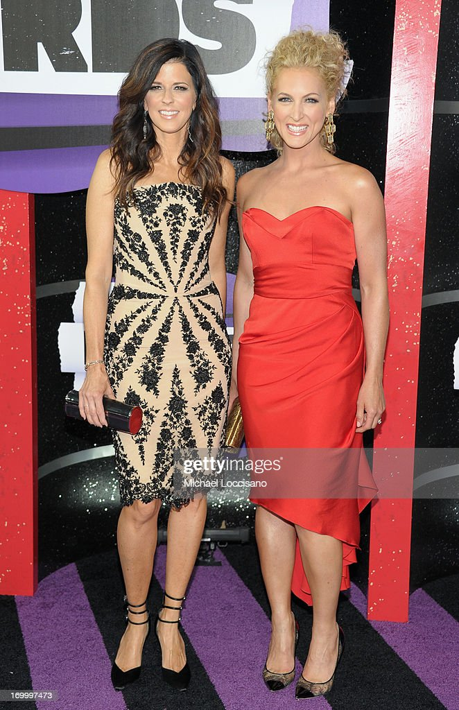 Karen Fairchild and Kimberly Schlapman of Little Big Town attend the 2013 CMT Music awards at the Bridgestone Arena on June 5, 2013 in Nashville, Tennessee.