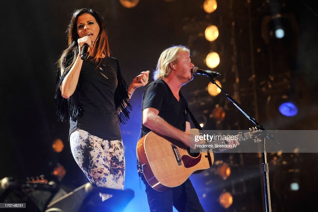 Karen Fairchild and Philip Sweet of Little Big Town perform at LP Field during the 2013 CMA Music Festival on June 7, 2013 in Nashville, Tennessee.
