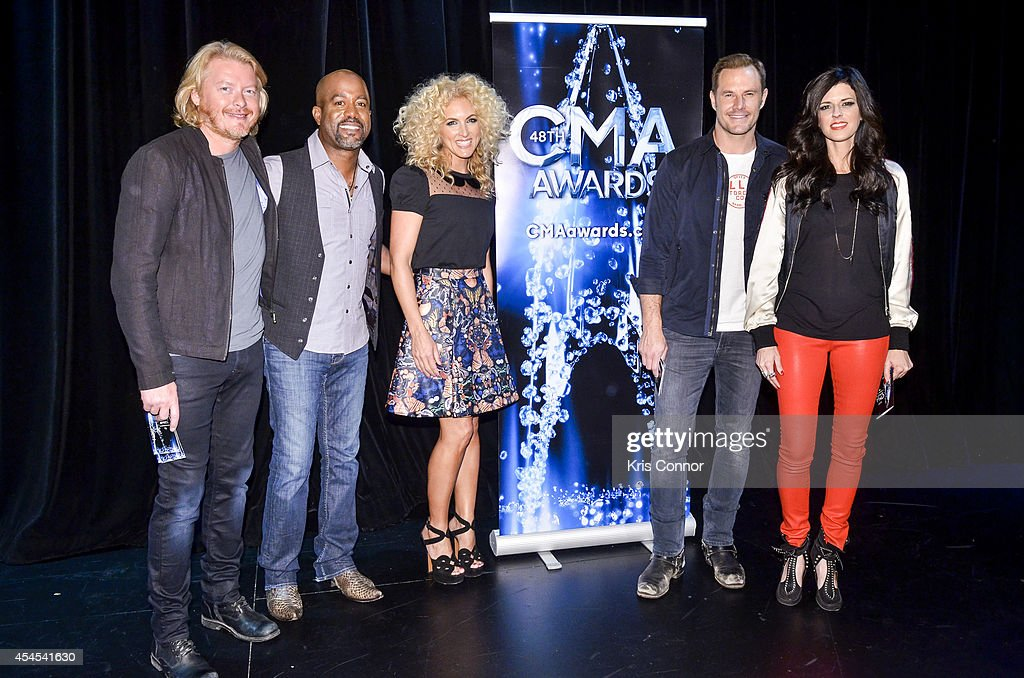 Karen Fairchild, Darius Rucker, Kimberly Schlapman, Jimi Westbrook and Phillip Sweet pose for a photo during during the 48th Annual CMA Awards Nominees Announcement at Best Buy Theater on September 3, 2014 in New York City.