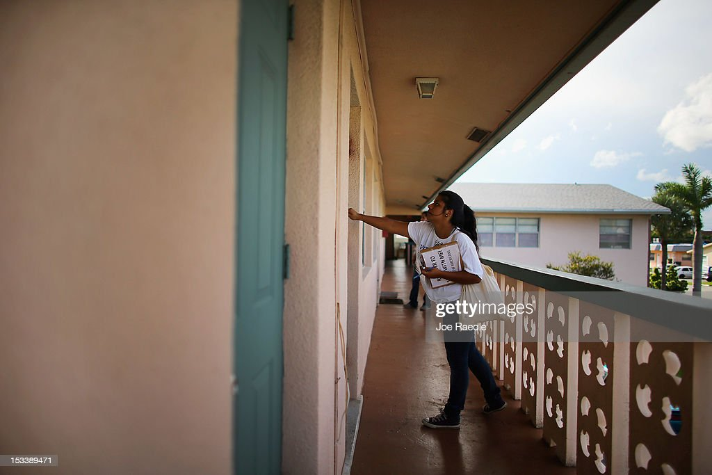 Karen Garcia knocks on a door in an apartment complex as she looks for people that have not registered to vote during a voter registration drive by...