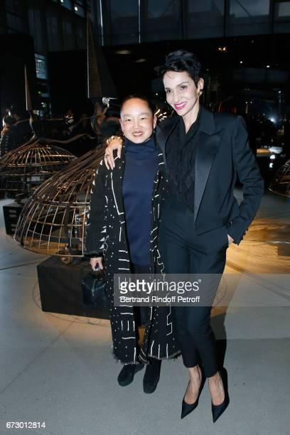 Karen Goude and Farida Khelfa pose in front the dress 'Farida' work of JeanPaul Goude during the 'Societe des Amis du Musee d'Art Moderne du Centre...