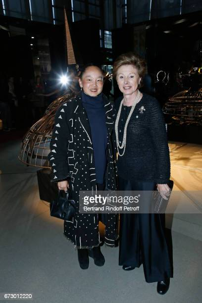 Karen Goude and MarieLouise de Clermont Tonnerre pose in front the works of JeanPaul Goude during the 'Societe des Amis du Musee d'Art Moderne du...
