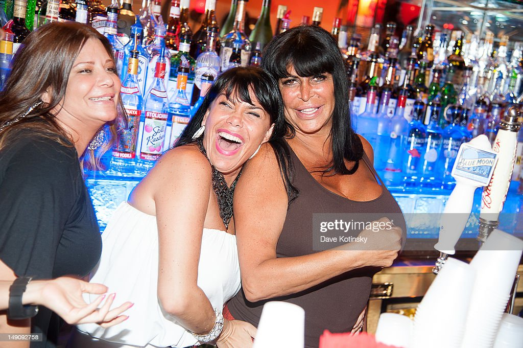 Karen Gravano,Angela '<a gi-track='captionPersonalityLinkClicked' href=/galleries/search?phrase=Big+Ang&family=editorial&specificpeople=8749866 ng-click='$event.stopPropagation()'>Big Ang</a>' Raiola and <a gi-track='captionPersonalityLinkClicked' href=/galleries/search?phrase=Renee+Graziano&family=editorial&specificpeople=7643222 ng-click='$event.stopPropagation()'>Renee Graziano</a> at Drunken Monkey on July 22, 2012 in New York City.