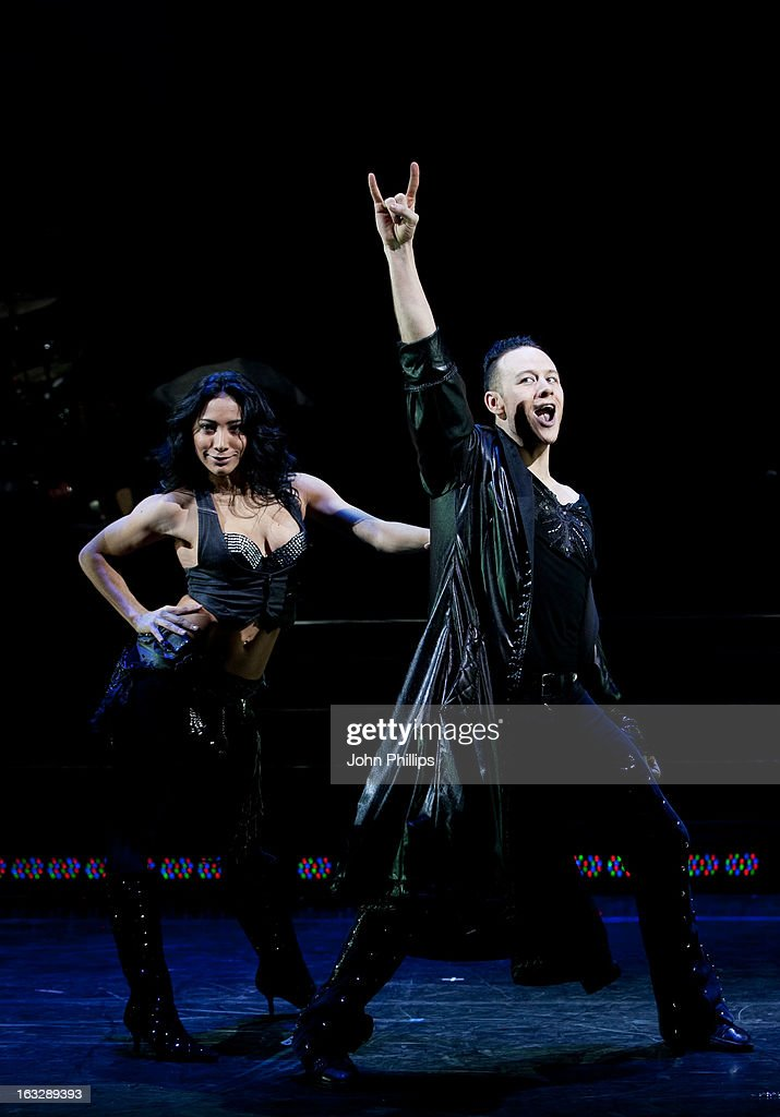 Karen Hauer and Kevin Clifton perform during a photocall for 'Burn The Floor' at Shaftesbury Theatre on March 7, 2013 in London, England.