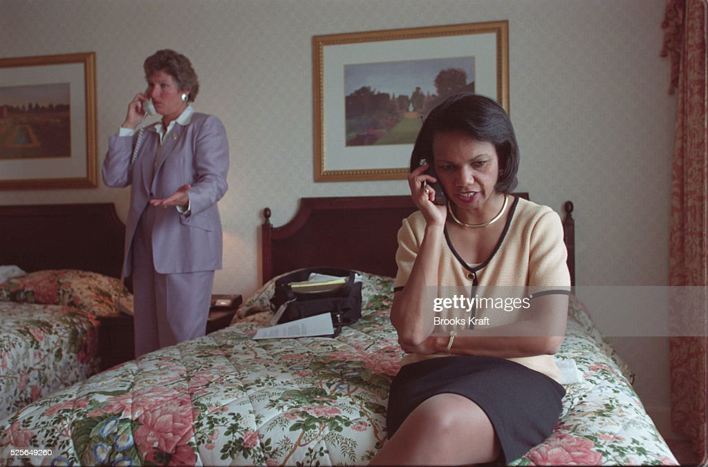 Karen Hughes Bush's Communications Director and Condoleezza Rice Bush's Foreign Policy Advisor both on the phone in a Washington DC hotel room