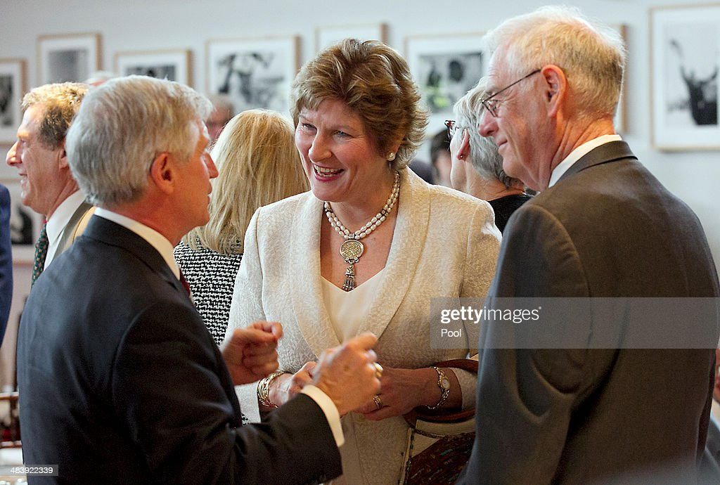 Karen Hughes former spokeswoman for President George W Bush talks to friends gathered for the address by her former boss as he addresses a private...