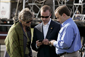 Karen Hughes Scott Stenzel and Scott McClellan campaign aides of President George W Bush review email messages on blackberry handheld electronic...