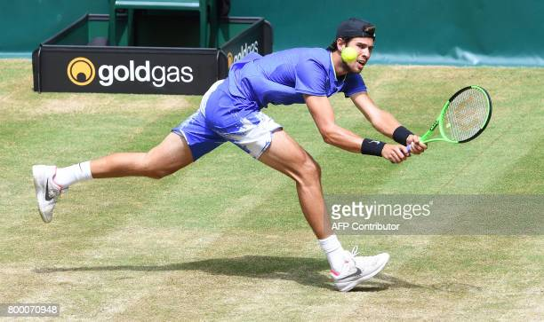 Karen Khachanov from Russia returns the ball to Andrey Rublev from Russia during the ATP tournament tennis in Halle western Germany on June 23 2017 /...