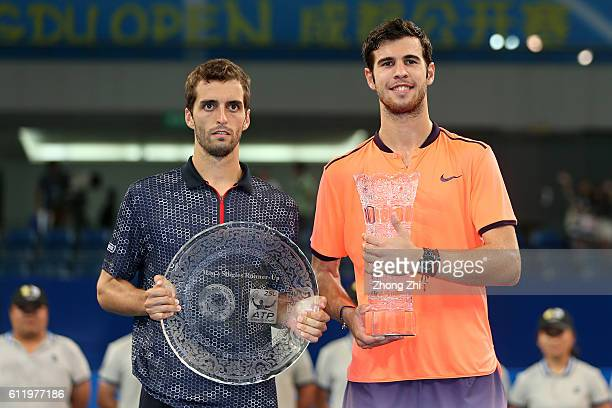 Karen Khachanov of Russia and Albert RamosVinolas of Spain pose with the trophy after the singles final match on Day 7 of 2016 ATP Chengdu Open at...