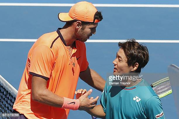 Karen Khachanov of Russia and Yoshihito Nishioka of Japan shakes hands after their match on day three of the 2017 Priceline Pharmacy Classic at...