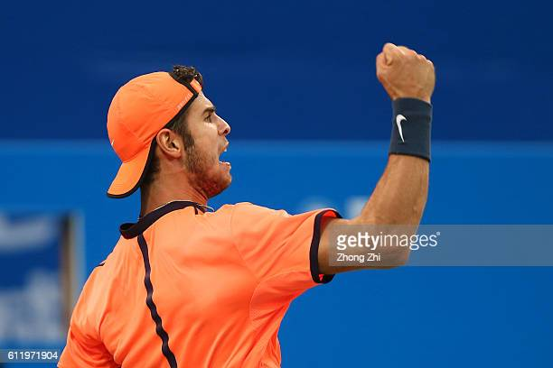 Karen Khachanov of Russia celebrates a point during the singles final match against Albert RamosVinolas of Spain on Day 7 of 2016 ATP Chengdu Open at...