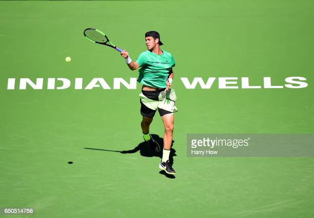Karen Khachanov of Russia hits a forehand in his match against Tommy Robredo of Spain at Indian Wells Tennis Garden on March 9 2017 in Indian Wells...