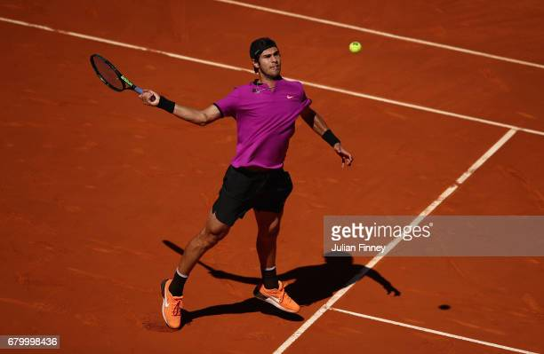 Karen Khachanov of Russia in action against David Goffin of Belgium during day two of the Mutua Madrid Open tennis at La Caja Magica on May 7 2017 in...