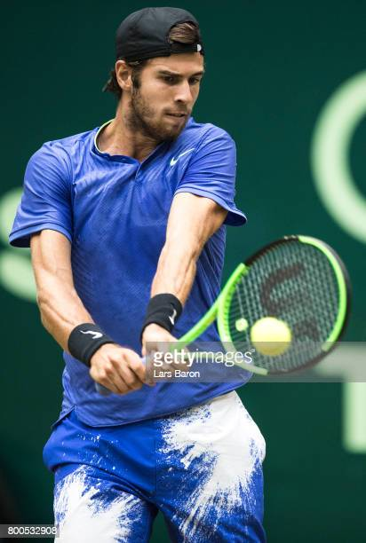 Karen Khachanov of Russia plays a backhand during his semi final match against Roger Federer of Switzerland during Day 8 of the Gerry Weber Open 2017...