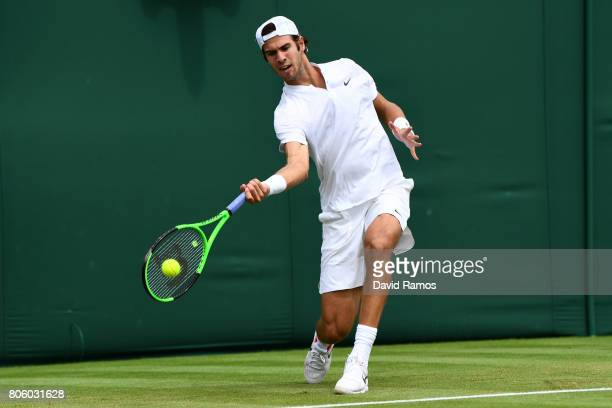 Karen Khachanov of Russia plays a forehand during the Gentlemen's Singles first round match against Andrey Kuznetsov of Russia on day one of the...