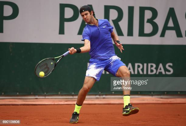 Karen Khachanov of Russia plays a forehand during the mens singles first round match against Nicolas Jarry of Chile on day three of the 2017 French...