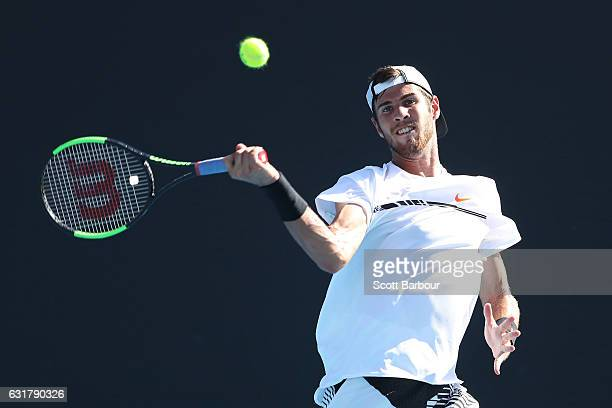 Karen Khachanov of Russia plays a forehand in his first round match against Adrian Nannarinno of France on day one of the 2017 Australian Open at...