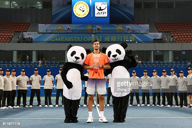 Karen Khachanov of Russia poses with the trophy after winning the singles final match against Albert RamosVinolas of Spain on Day 7 of 2016 ATP...