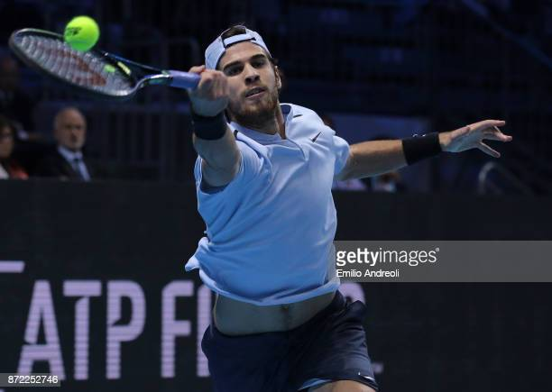 Karen Khachanov of Russia returns a forehand in his group stage match against Borna Coric of Croatia during Day 3 of the Next Gen ATP Finals on...