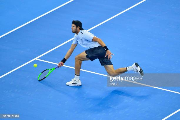 Karen Khachanov of Russia returns a shot against Rafael Nadal of Spain during the Men's singles 2rd round on day six of 2017 China Open at the China...