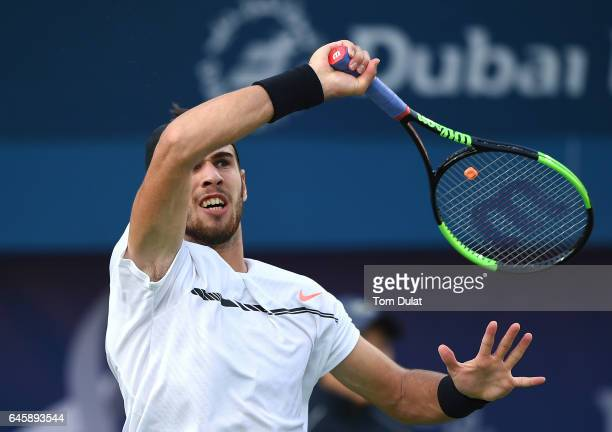 Karen Khachanov of Russia returns a shot during his match against Roberto Bautista Agut of Spain on day two of the ATP Dubai Duty Free Tennis...