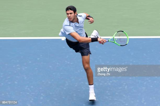 Karen Khachanov of Russia returns a shot during the match against Denis Istomin of Uzbekistan during Day 3 of 2017 ATP Chengdu Open at Sichuan...
