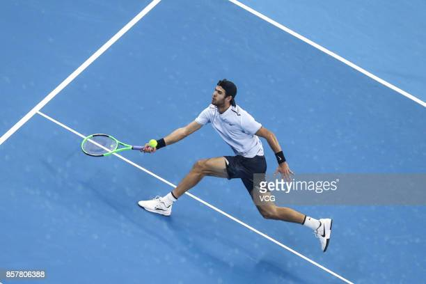 Karen Khachanov of Russia returns a shot during the Men's singles second round match against Rafael Nadal of Spain on day six of the 2017 China Open...