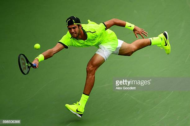 Karen Khachanov of Russia returns a shot to Kei Nishikori of Japan during his second round Men's Singles match on Day Four of the 2016 US Open at the...