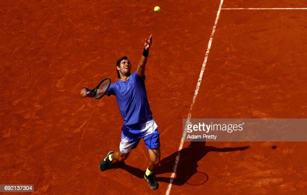 Karen Khachanov of Russia serves during the mens singles first round match against John Isner of The United States on day eight of the 2017 French...