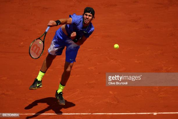 Karen Khachanov of Russia serves during the men's singles fourth round match against Andy Murray of Great Britain on day nine of the 2017 French Open...
