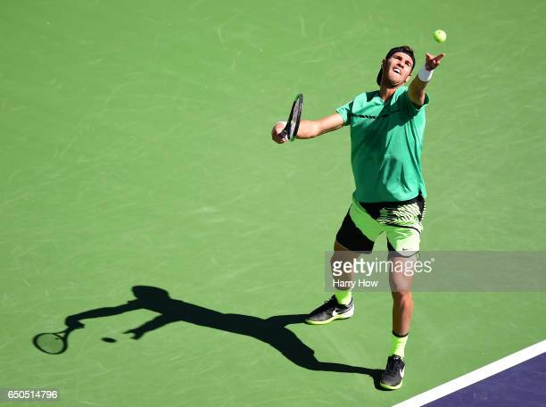 Karen Khachanov of Russia serves in his match against Tommy Robredo of Spain at Indian Wells Tennis Garden on March 9 2017 in Indian Wells California
