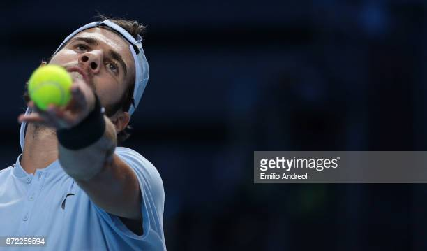 Karen Khachanov of Russia serves the ball in his match against Borna Coric of Croatia during Day 3 of the Next Gen ATP Finals on November 9 2017 in...