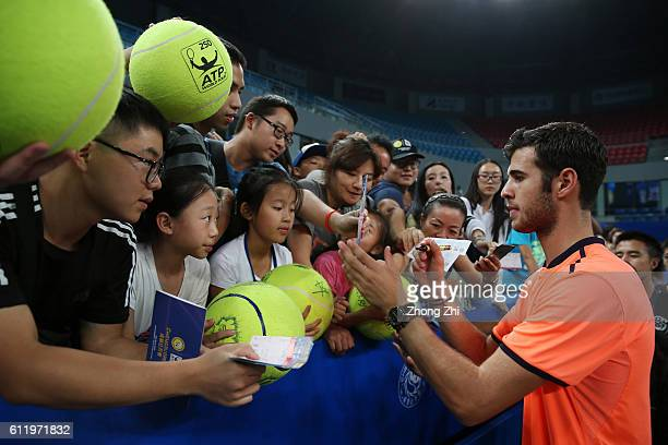 Karen Khachanov of Russia signs autographs for fans after winning the singles final match against Albert RamosVinolas of Spain on Day 7 of 2016 ATP...