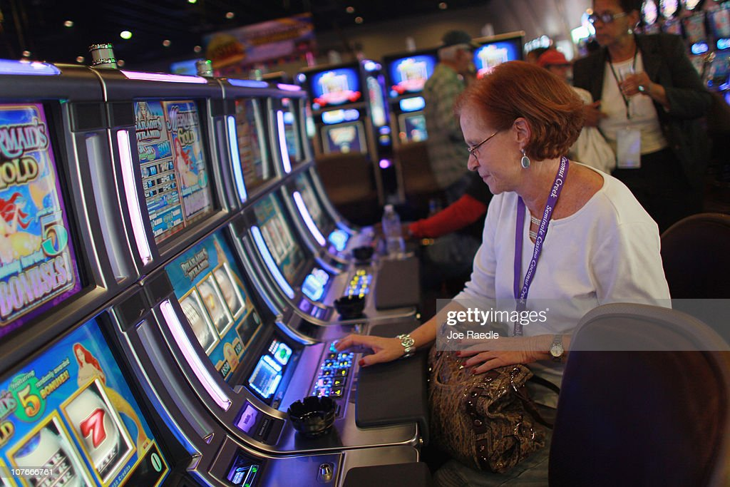 Karen Krebs plays a slot machine during the grand opening of the newest building at the Seminole Casino Coconut Creek on December 17, 2010 in Coconut Creek, Florida. The site offers up an additional 400-plus gaming positions, a new restaurant and a new venue with more space to gamble, dine and party.