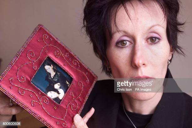 Karen Lawson holding a photo of her daughter Sarah at her Worthing home West Sussex Sarah's father James Lawson from Hove West Sussex pleaded guilty...