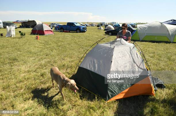 Karen Lively and her dog PJ set up a tent at Toadstock a 3day music festival after she arrived in town from Dallas Texas for the total solar eclipse...