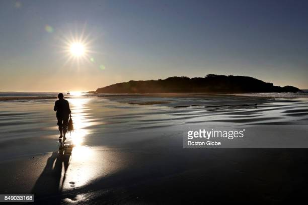 Karen Maslow one of the owners of Salt Island walks along the beach in Gloucester MA on Sep 8 2017 Salt Island is so close to Good Harbor Beach in...