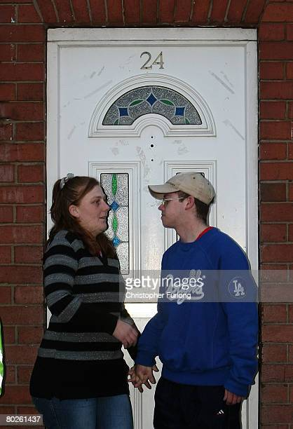 Karen Matthews mother of Shannon Matthews and her partner Craig Meehan pose for photographers outside their home in Moorside Road Dewsbury near Leeds...