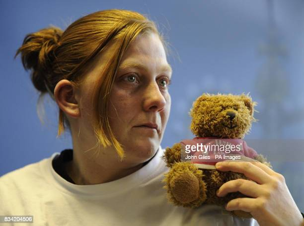 Karen Matthews the mother of missing 9yearold Shannon Matthews holds her daughters favourite teddy bear as she makes an emotional appeal for her safe...