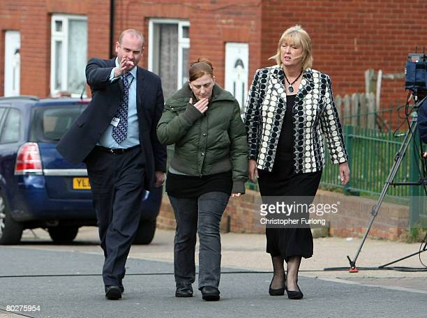 Karen Matthews the mother of Shannon Matthews is led away by detectives in Moorside Road Dewsbury near Leeds on March 17 Dewsbury England Shannon...