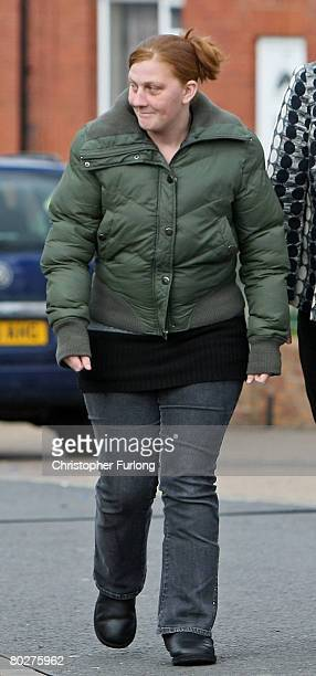 Karen Matthews the mother of Shannon Matthews smiles to a neighbour as she is led away by detectives in Moorside Road Dewsbury near Leeds on March 17...