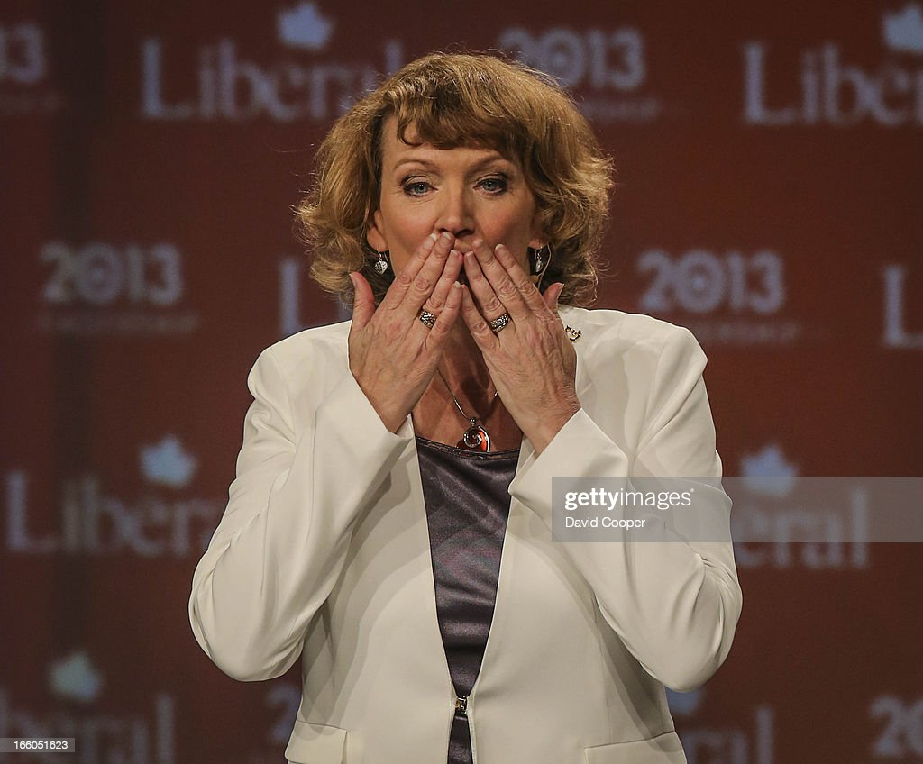 Karen McCrimmon blows kisses to the crowd as she takes her leave at the federal Liberal showcase at the Metro Toronto Convention Centre.