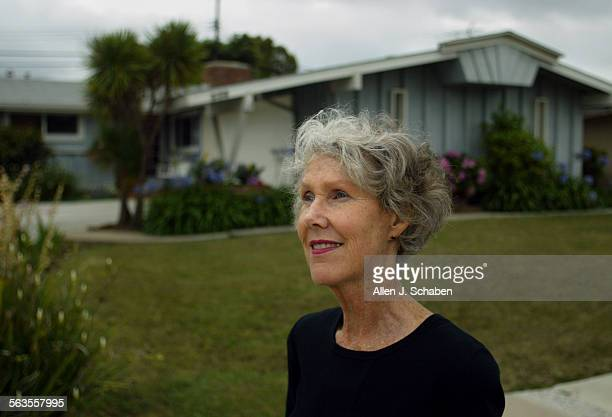 Karen Millar of Costa Mesa stands in front of her Costa Mesa home located about 100 yards from the Pacific Amphitheatre which is reopening following...