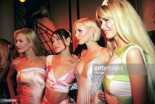 Karen Mulder Carla Bruni Nadja Auermann and Claudia Schiffer attend the Versace High Fashion Show at the Ritz Hotel on January 11995 in Paris France