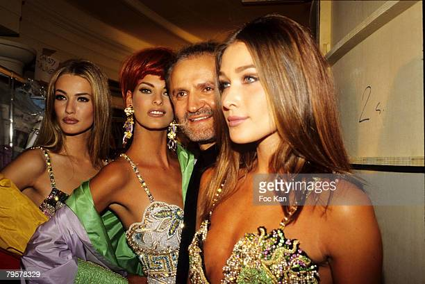 Karen Mulder Linda Evangelista Gianni Versace and Carla Bruni attend the Versace High Fashion Show at the Ritz Hotel on January 11992 in Paris France