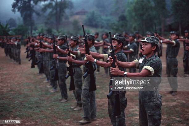 Karen National Liberation Army soldiers on early morning parade in their Manerplaw stronghold on the banks of the Salween River on the Thai/Burma...