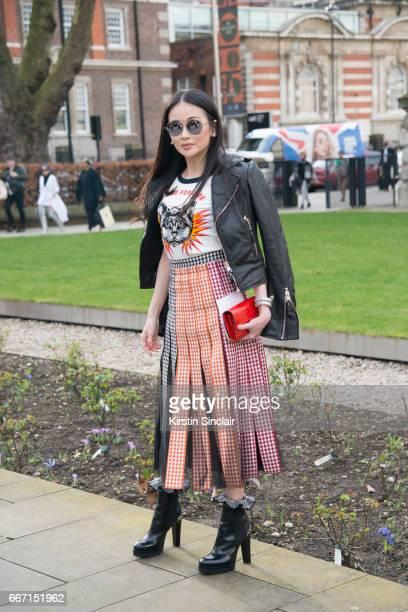 Karen Ng wears a Christopher Kane skirt Gucci T shirt Balenciaga jacket Alexander McQueen boots and Maison Margiela sunglasses on day 4 of London...