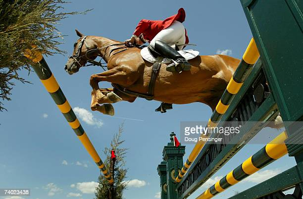 Karen O'Connor from The Plains Virginia atop Theodore O'Connor competes in the Stadium Jumping Phase as they finished third at the 2007 Rolex...